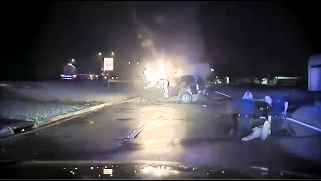 Dallas police rescue man from burning car