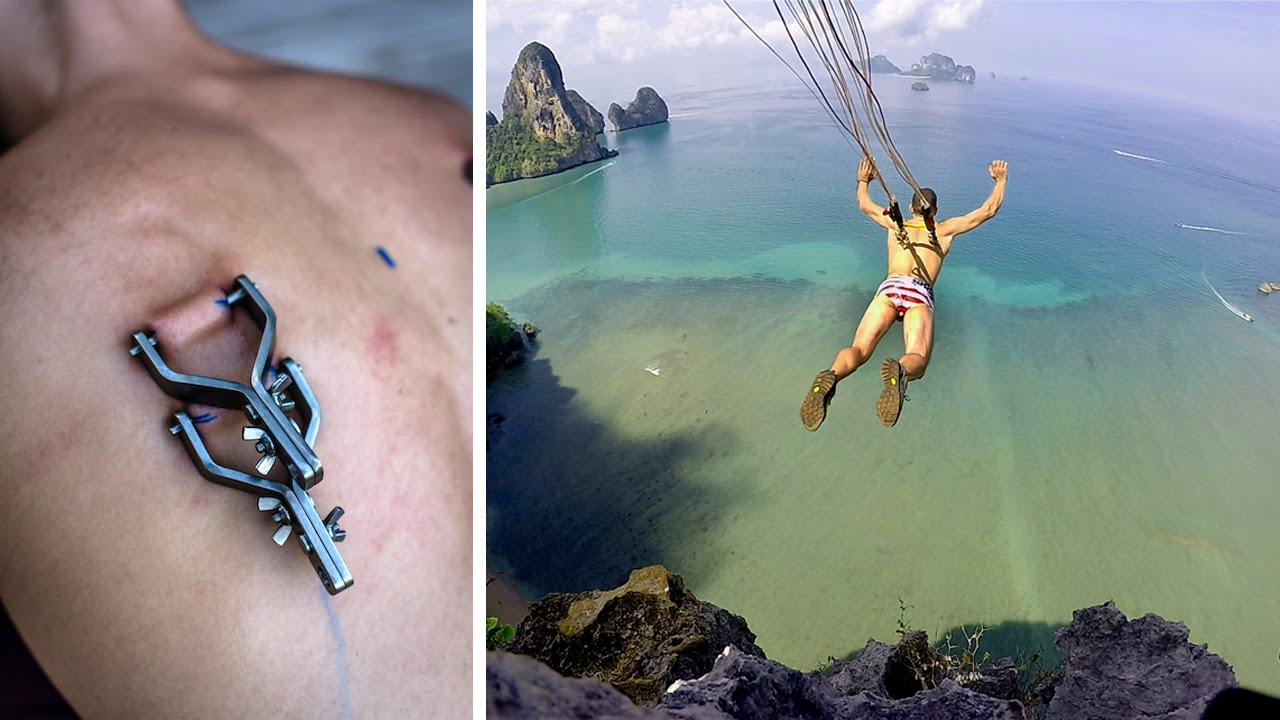 Guy Attaches Parachute to Piercings in Back and Jumps Off Cliff (VIDEO)